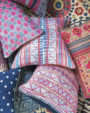 Brightly colored pillows layered on top of one another