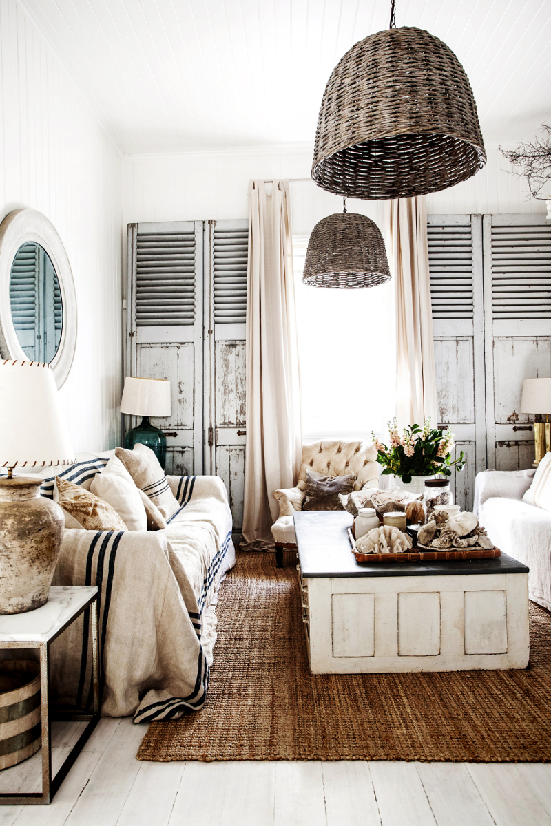 Rustic Bohemian Interior Design in a Vintage Cottage living room by Kara Rosenlund. #livingroom #rusticdecor #beachy #boho #shutters #wicker
