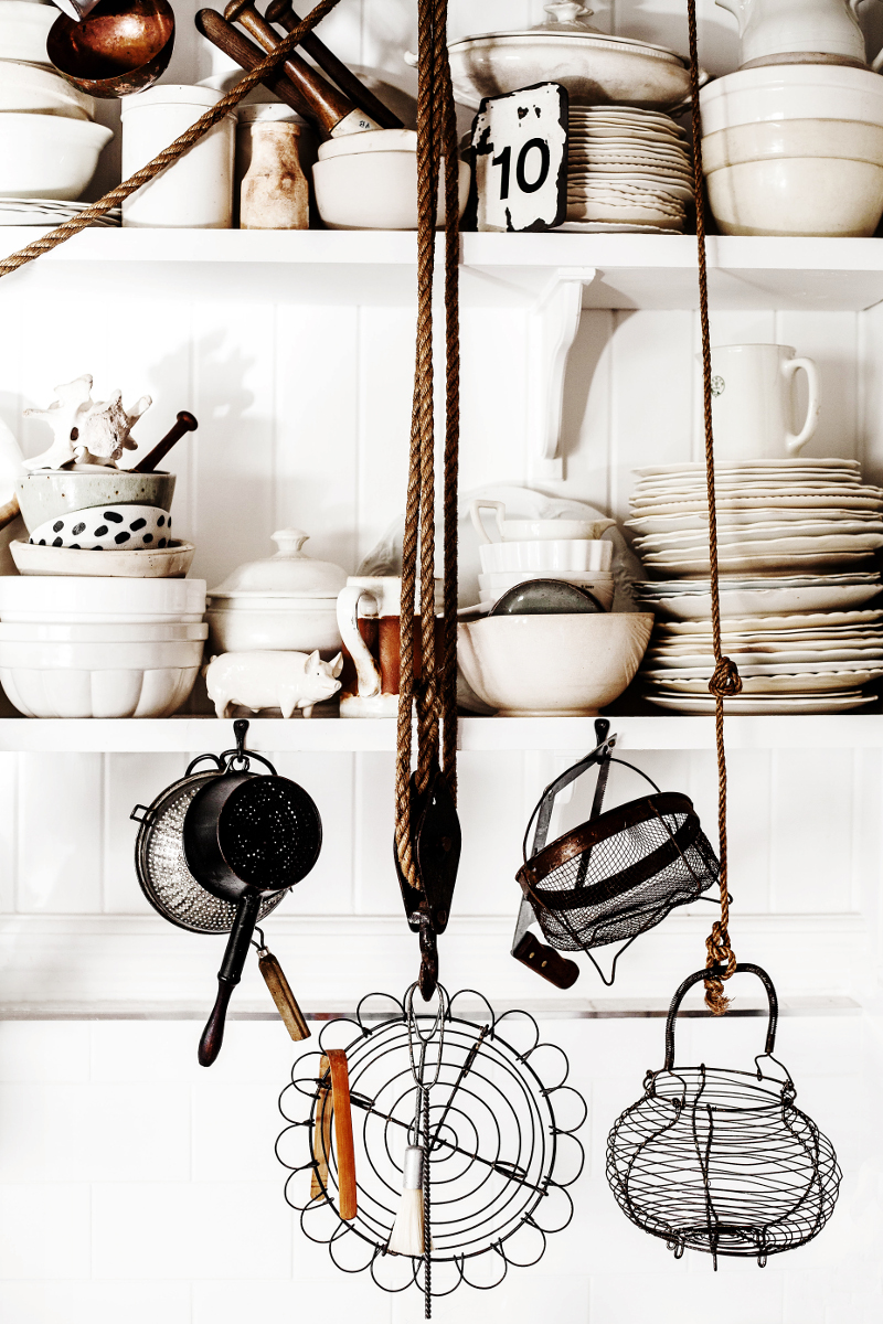 Rustic Bohemian Interior Design Kitchen with open shelves full of vintage treasures. Design by Kara Rosenlund. #rusticdecor #farmhousekitchen #cottagekitchen #shelves