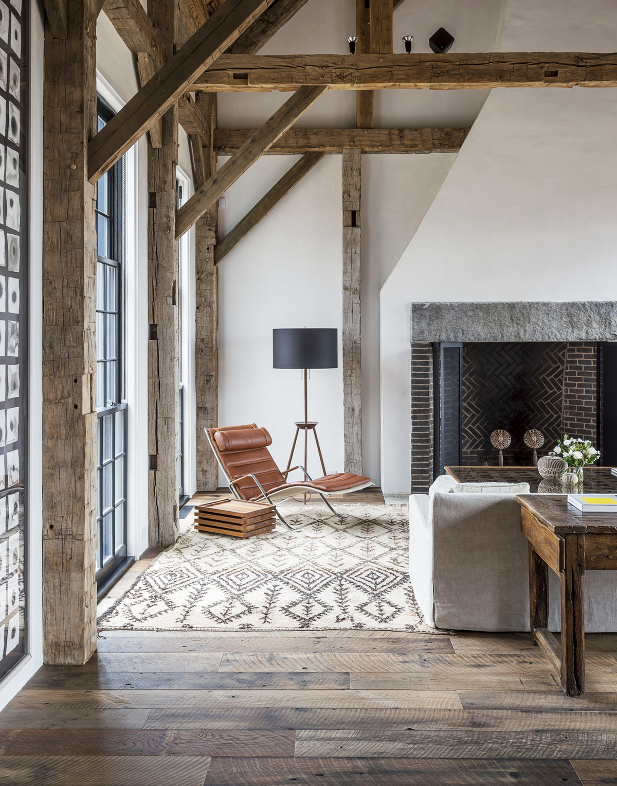 Wood beams and black steel windows in a living room with modern rustic decor #modernfarmhouse #rusticbeams