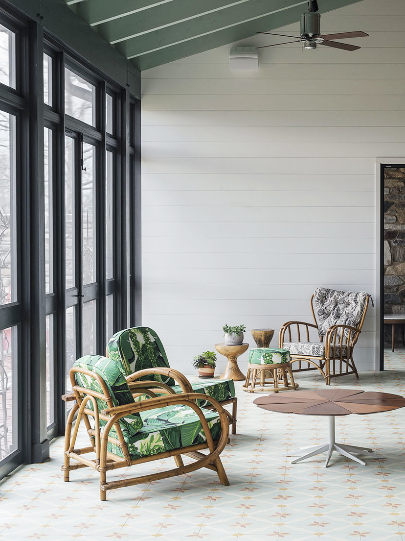Modern decor and green upholstery on a porch in a country home in Hudson New York