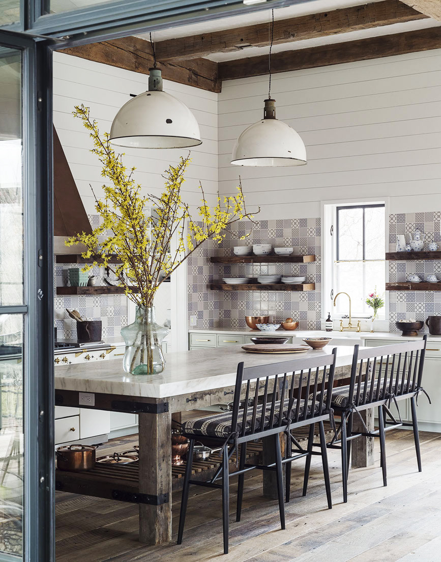 A rustic yet elegant country kitchen with high ceilings, shiplap, barn style pendants and wood beams. #modernfarmhouse #farmhousekitchen #rusticdecor