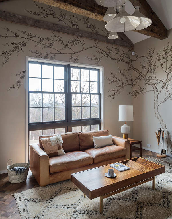 A lovely rustically elegant den with tree mural painted on wall and wood beams. #modernfarmhouse #wallmural