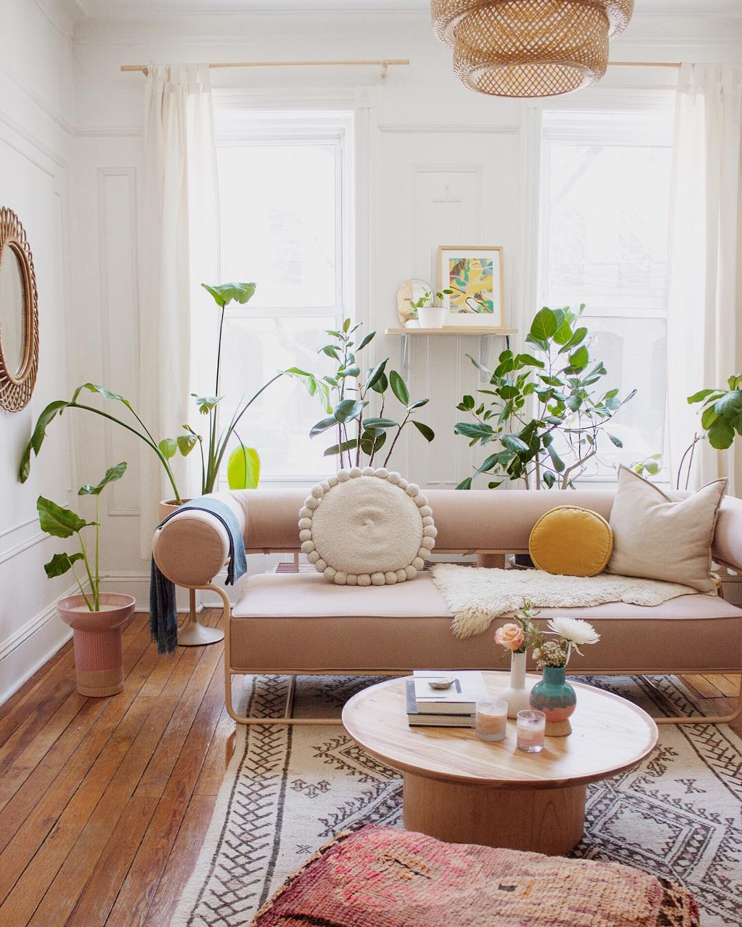 Pink boho chic living room in Brooklyn apartment of Mallory Fletchall.